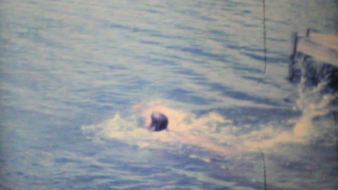 Girl Doing Tricks In The Lake 1968 Vintage 8mm film Stock Video Footage