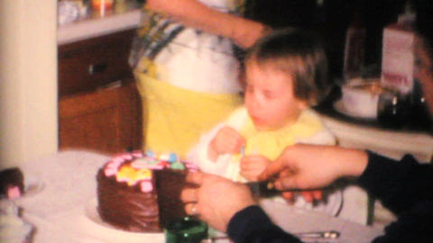 Two Year Old Girl Blows Out Candles 1968 Vintage 8mm film Stock Video Footage