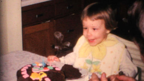 Two Year Old Girl Blows Out Candles 1968 Vintage 8mm film Footage