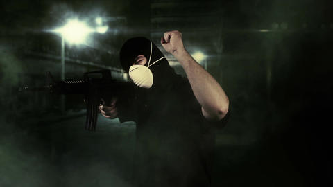 Masked Commando Man with Gun in Scary Alley 1 Stock Video Footage