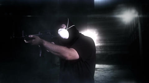 Masked Commando Man with Gun in Scary Alley 6 Stock Video Footage