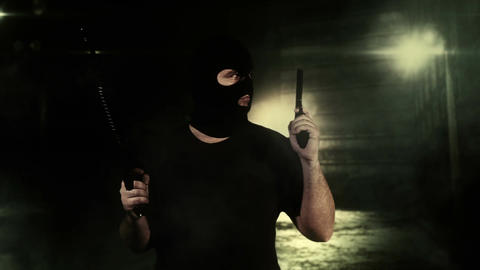Masked Guard Man with Double Guns in Scary Alley 11 Stock Video Footage