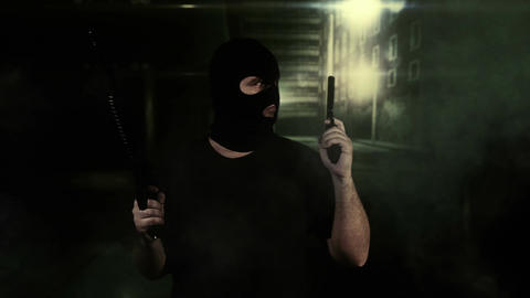 Masked Guard Man with Double Guns in Scary Alley 15 Stock Video Footage