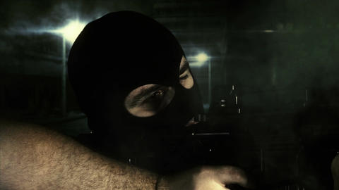 Masked Guard Man with Gun in Scary Alley 1 1 Stock Video Footage