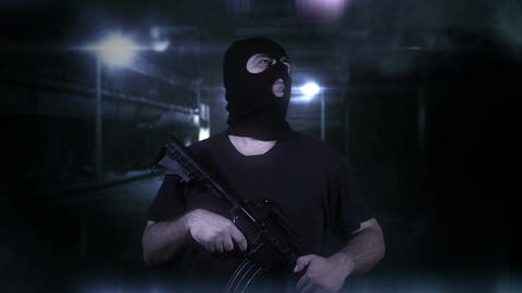 Masked Guard Man with Gun in Scary Alley 2 Stock Video Footage