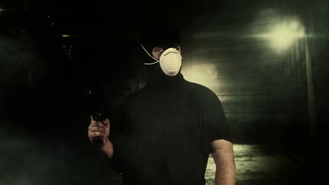 Masked Guard Man with Gun in Scary Alley 11 Stock Video Footage