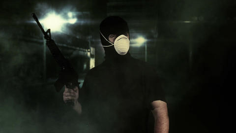 Masked Guard Man with Gun in Scary Alley 13 Stock Video Footage