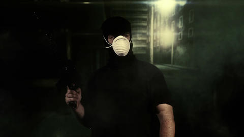 Masked Guard Man with Gun in Scary Alley 15 Stock Video Footage