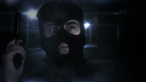 Masked Man with Gun in Scary Alley 2 Stock Video Footage