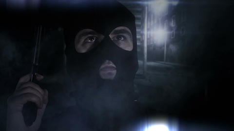 Masked Man with Gun in Scary Alley 4 Stock Video Footage
