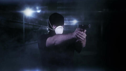Masked Man with Gun Shooting in Scary Alley 2 Stock Video Footage