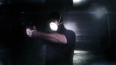 Masked Man with Gun Shooting in Scary Alley 6 Stock Video Footage
