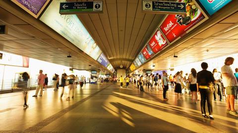 Timelapse - Crowd in Aerial subway station - Siam BTS Station - Bangkok Footage