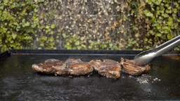 Cooking Steak on a Barbecue Stock Video Footage