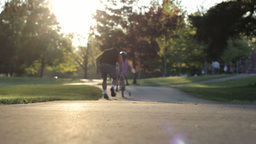 Excited Father Helps Daughter Ride Her New Bike Up Hill Stock Video Footage