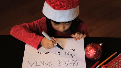 Happy Six Year Old Girl Writing Santa Claus Stock Video Footage