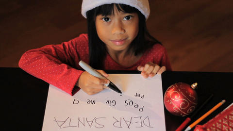 Happy Six Year Old Girl Writing Santa Claus Footage