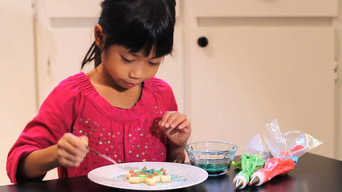 Excited Girl Adds Finishing Touch To Christmas Cookie Footage