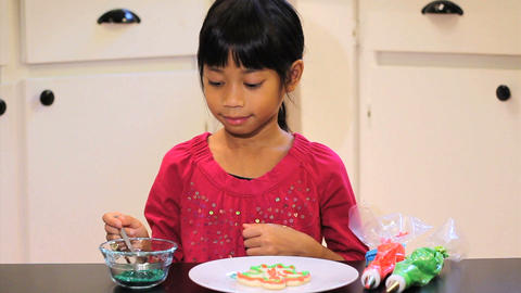 Girl Adds Sprinkles To Her Christmas Cookie Footage