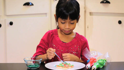 Girl Adds Sprinkles To Her Christmas Cookie Stock Video Footage