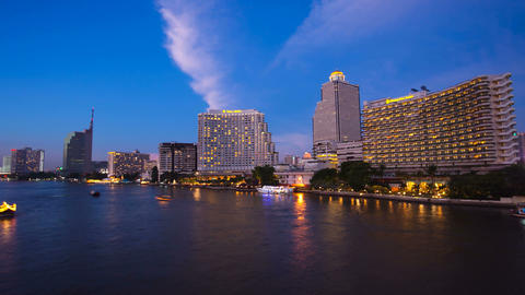 Timelapse - City at sunset with lighted boats on the river Stock Video Footage
