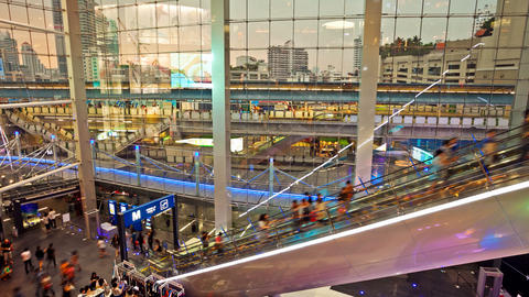 Timelapse Shopping mall escalators, with aerial subway in... Stock Video Footage