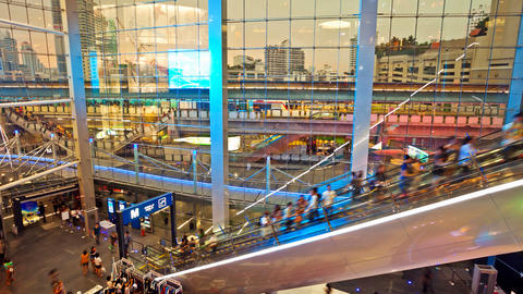 Timelapse Shopping mall escalators, with aerial subway in background - Bangkok Terminal 21 Footage