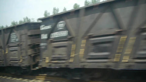freight-train in rural countryside.Speeding train travel,scenery outside window Footage