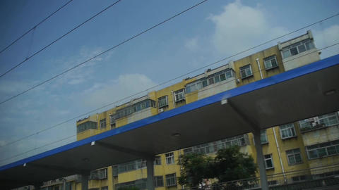 Real estate construction site.Altocumulus cloud in blue sky.Speeding train trave Footage