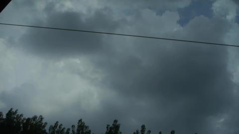 Altocumulus cloud in blue sky in rural countryside.Speeding train travel,scenery Footage