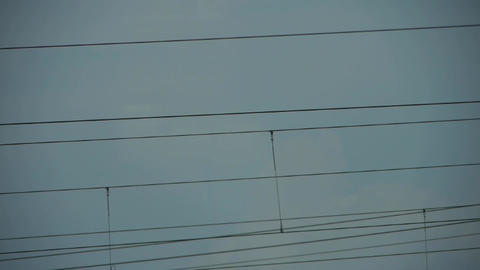 High-voltage Wire Tower In Urban City,scenery Outside Window. stock footage