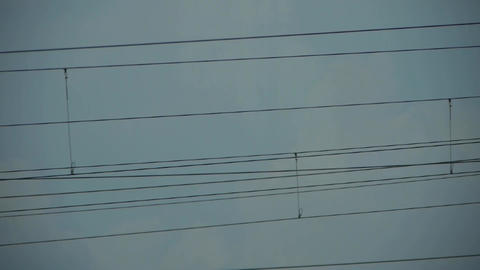 High-voltage wire tower in urban city,scenery outside window Stock Video Footage