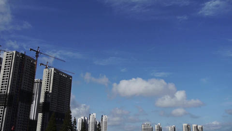 Movement of altocumulus clouds in sky,building high-rise & scaffolding at ur Footage