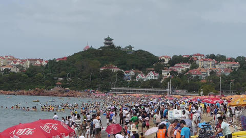 A lot of people at crowded bathing beach.China's Qingdao... Stock Video Footage