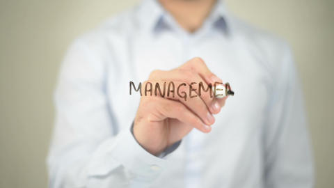 Management and Marketing, man writing on transparent screen Footage