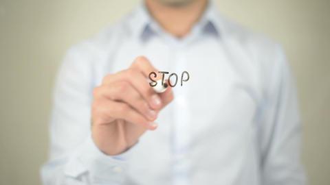 Stop Killing , man writing on transparent screen Footage