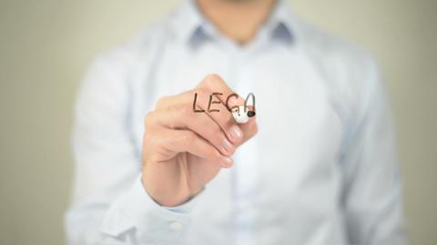 Lega Action , man writing on transparent screen Footage