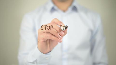 Stop Pyramid Scheme , man writing on transparent screen Footage