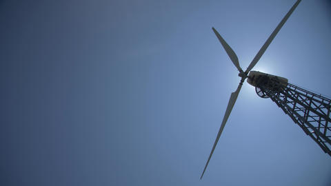 Wind turbine blades Slow rotation on blue sky background Footage