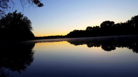 Sunrise on Horizon Over Calm Flowing River and Morning Mist. River Mist Surrounded by Forest at Footage