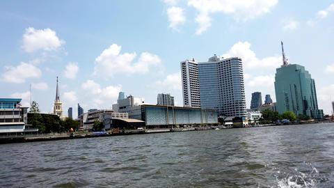 Bangkok, Thailand - 2019-03-03 - Speeding Canal Boat Passes High Rise Hotels Footage
