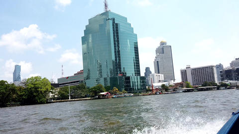Bangkok, Thailand - 2019-03-03 - Speeding Canal Boat Passes Hotels and Other Footage