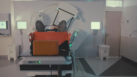 Patient Getting Radiation Therapy Treatment Inside A Modern Radiotherapy Room Archivo
