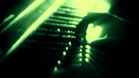 Man Playing a Green Particles Piano - Hands Close Up - Motion Background Animation