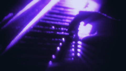Man Playing a Purple Particles Piano - Hands Close Up - Motion Background Animation