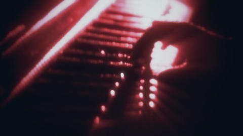 Man Playing a Red Particles Piano - Hands Close Up - Motion Background Animation