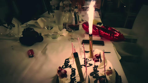 burning sparkler on a birthday cake and with happy birthday written. happy birthday sparkler burning Footage