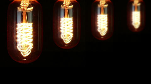 turn on and turn off in slow motion, four retro vintage light bulb with old technology with filament Live Action
