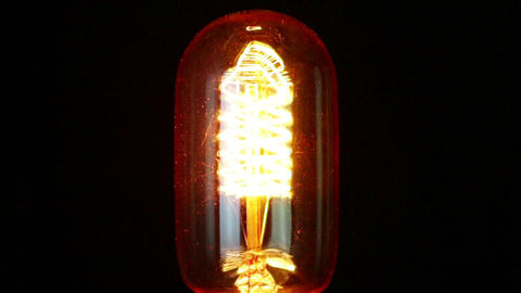 turn on and turn off in slow motion, one retro vintage light bulb with old technology with filament Footage