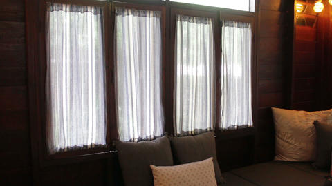Living room interior window with handmade curtains Footage